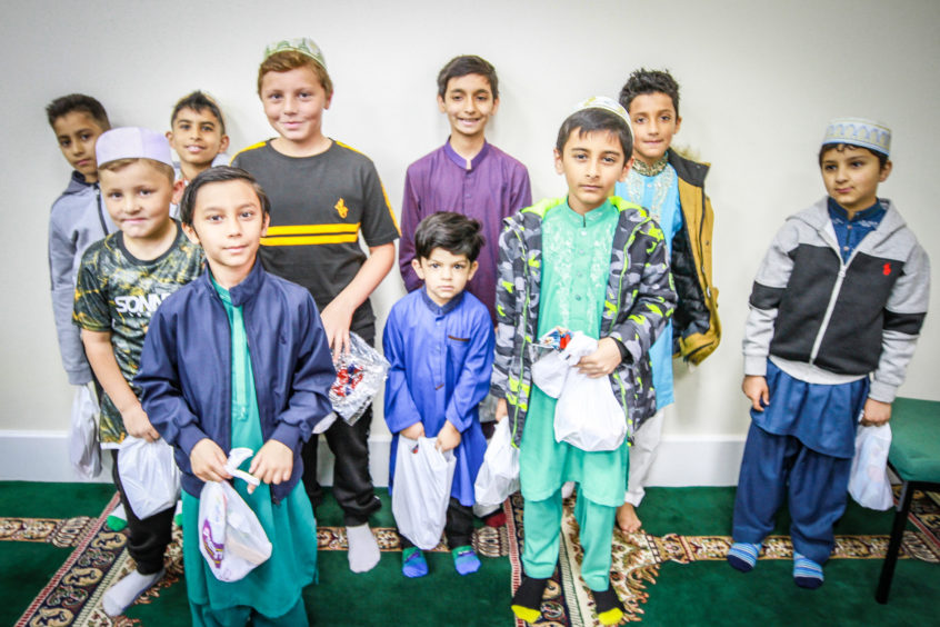 Children with goodie bags after prayers and celebrations at Dundee Islamic Society Mosque to celebrate Eid.
