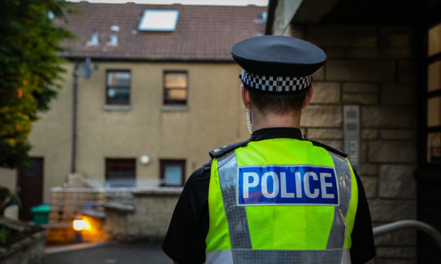 Police at the scene of the two deaths in Elie.