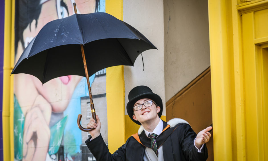 Calum Wilson who graduated in Scots/English Law in top hat with umbrella.  Picture by Kris Miller/DCT Media.