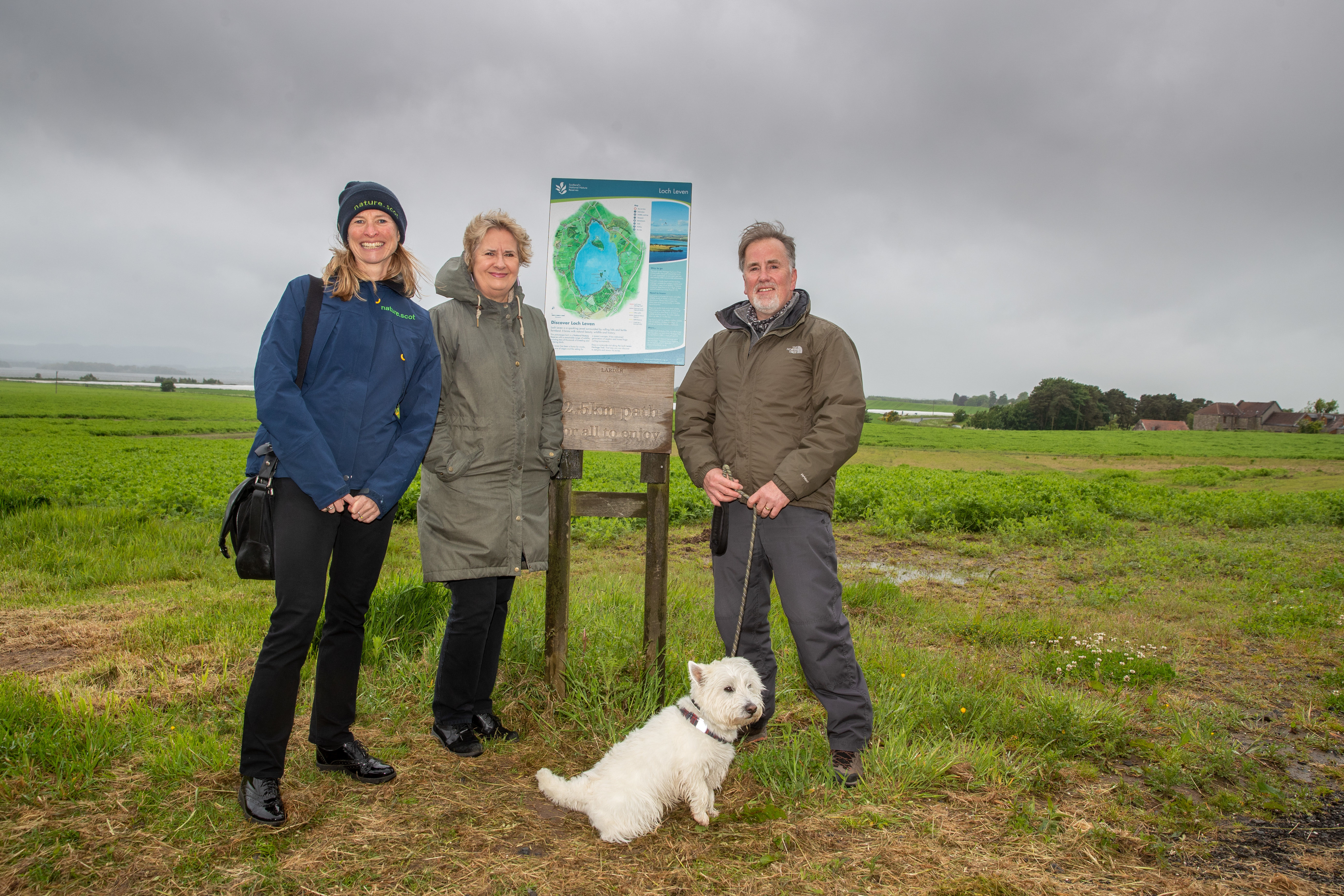 Roseanna Cunningham MSP, volunteer Dave Alston and his dog Murray and SNH Chief Executive Francesca Osowska were at Loch Leven, to mark the creation of more than 100 miles of new and improved paths across Scotland.