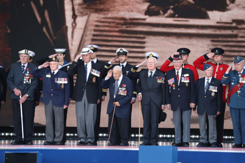 D-Day veterans take the stage during the commemorations for the 75th Anniversary of the D-Day landings at Southsea Common, Portsmouth.