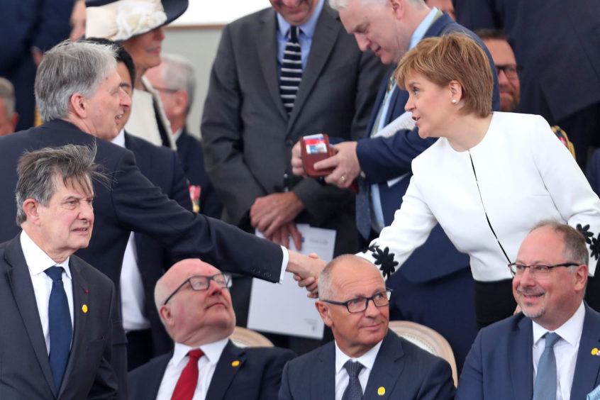 Chancellor of the Exchequer Philip Hammond and Scottish First Minister Nicola Sturgeon at the event.