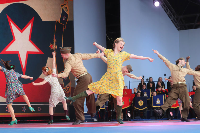 Dancers perform on stage during the event.