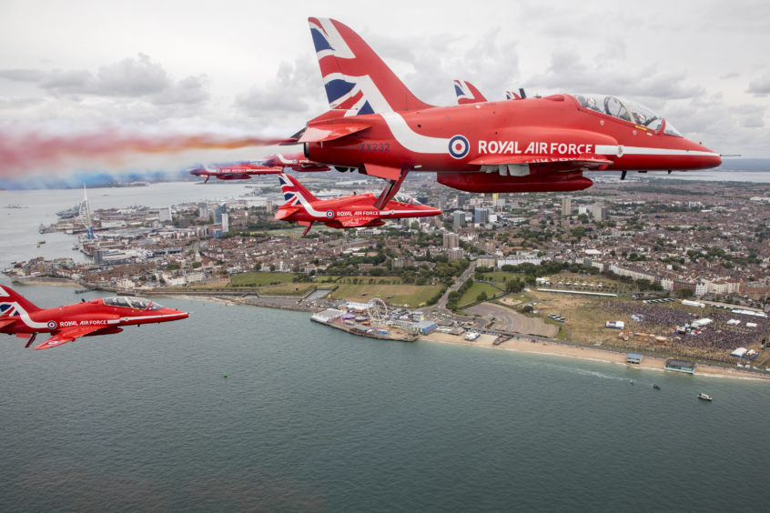 Royal Air Force Aerobatic Team, The Red Arrows flying over the commemorations at Southsea Common in Portsmouth for the 75th Anniversary of the D-Day landings.