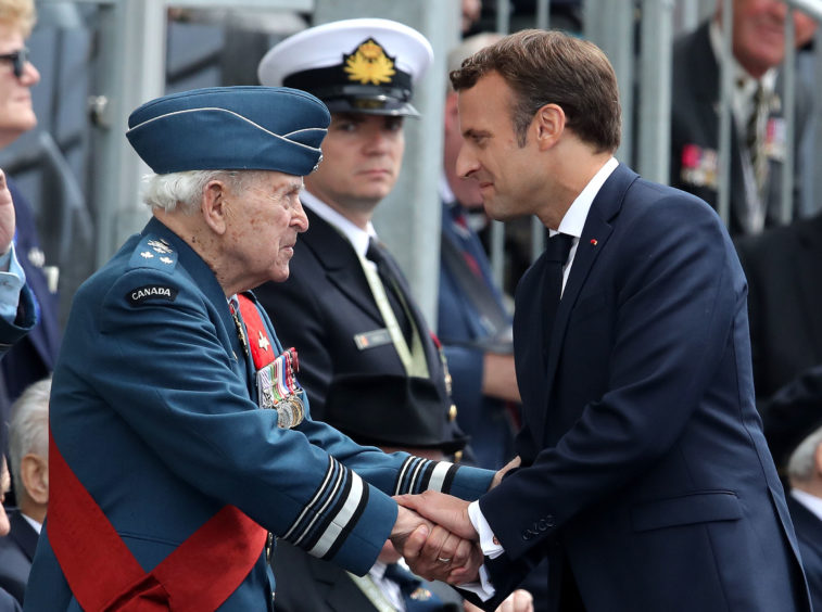 French President Emmanuel Macron shakes hands with a Canadian D-Day veteran during the commemorations for the 75th Anniversary of the D-Day landings at Southsea Common in Portsmouth.