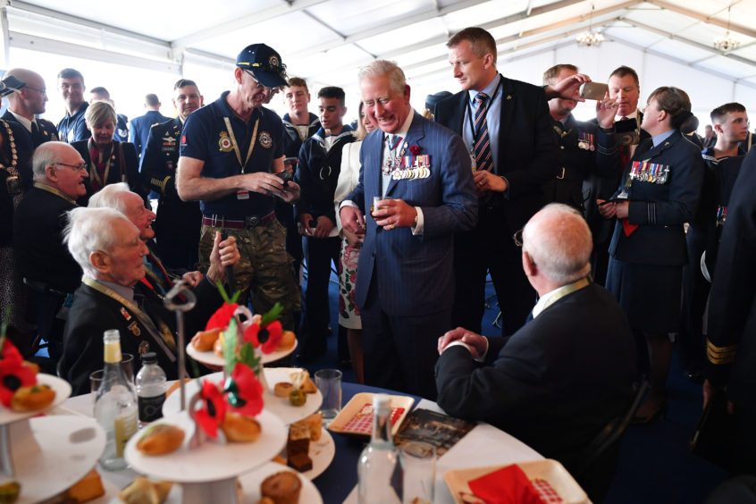 The Prince of Wales meeting veterans.