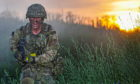 A Royal Marine from X-Ray Company, 45 Commando assaults the final objective in Rinkenby, Sweden on Baltic Protector.