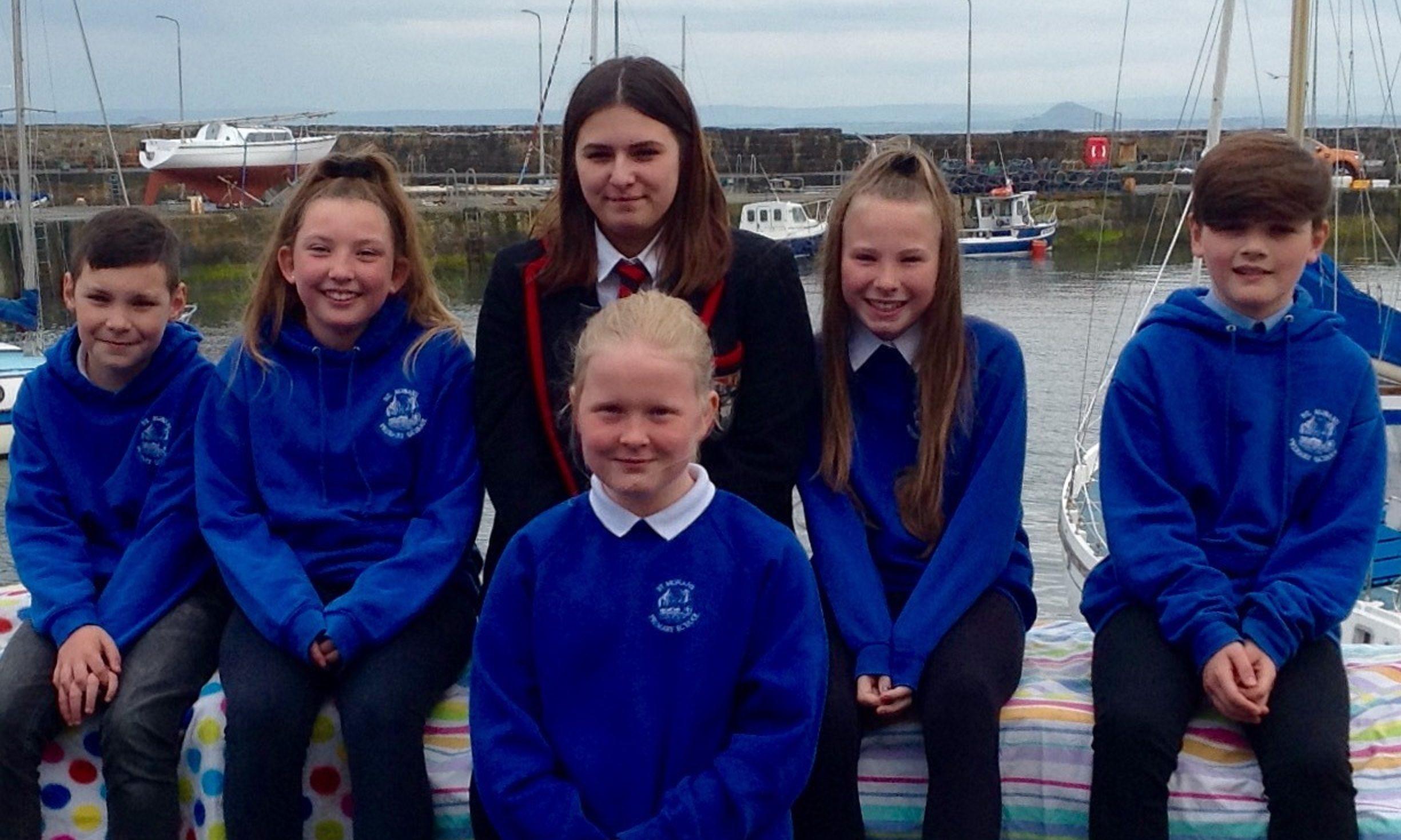 This years sea queen Mya Horsburgh, back centre, with Robert McNally, Georgia Syme, Erin Clarke, Aron Kelly, Danielle Robertson
