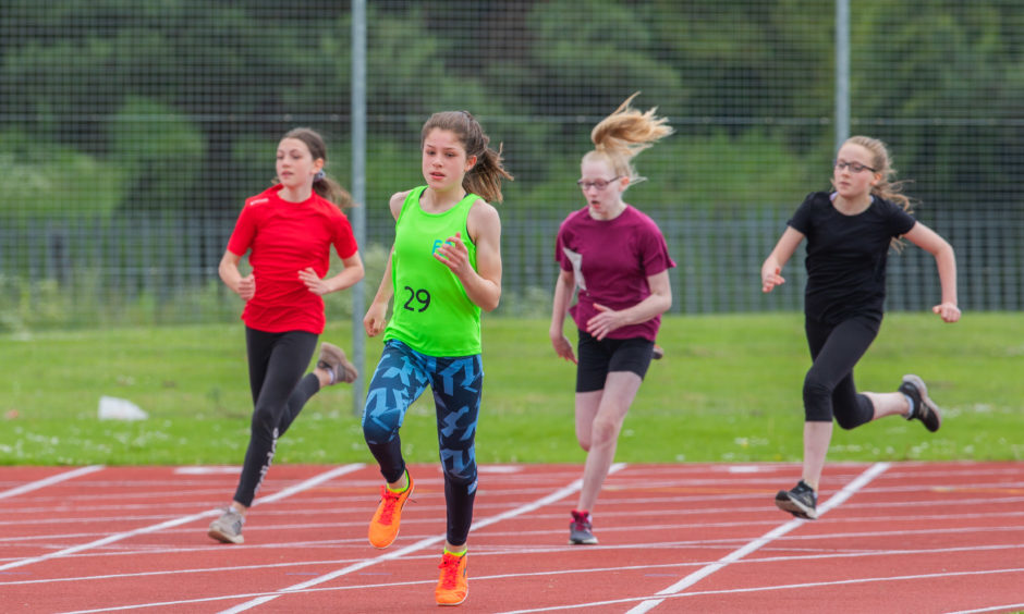 Laurie Hunter (Primary 7 at Fossoway Primary School) leading the way in the Primary 7 girls 200 metres.