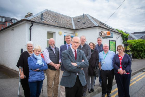 John Swinney MSP (front) and Councillor Mike Williamson (behind) meeting local business owners, members of Community Council and local residents to discuss their concerns. Public Toilets, West Lane, Pitlochry.