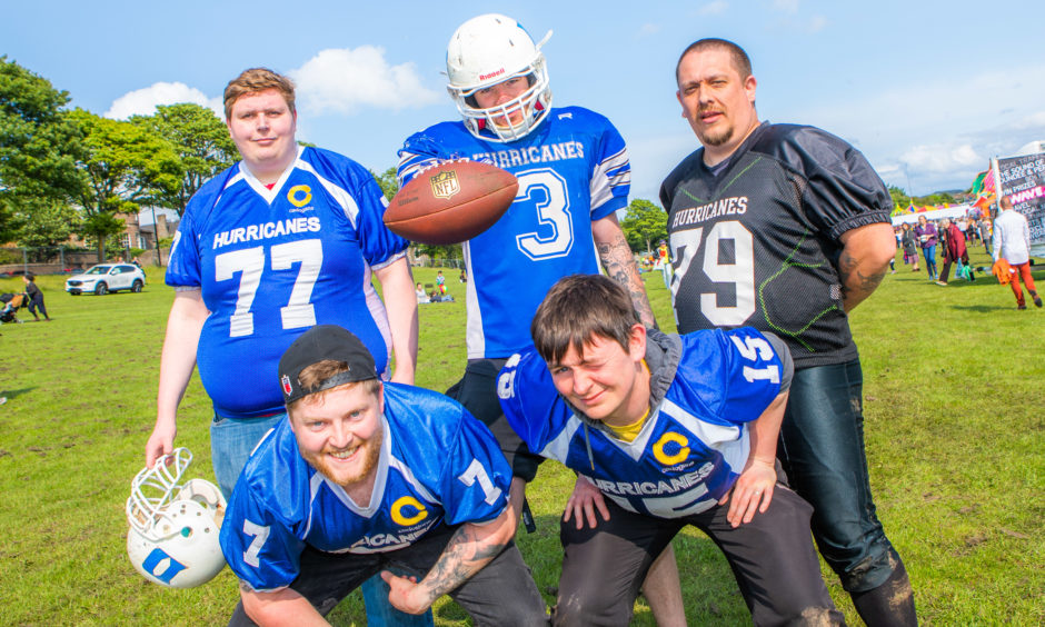 Scott Ritchie with other members of the Dundee Hurricanes American Football team, there to drum up support and new members.
