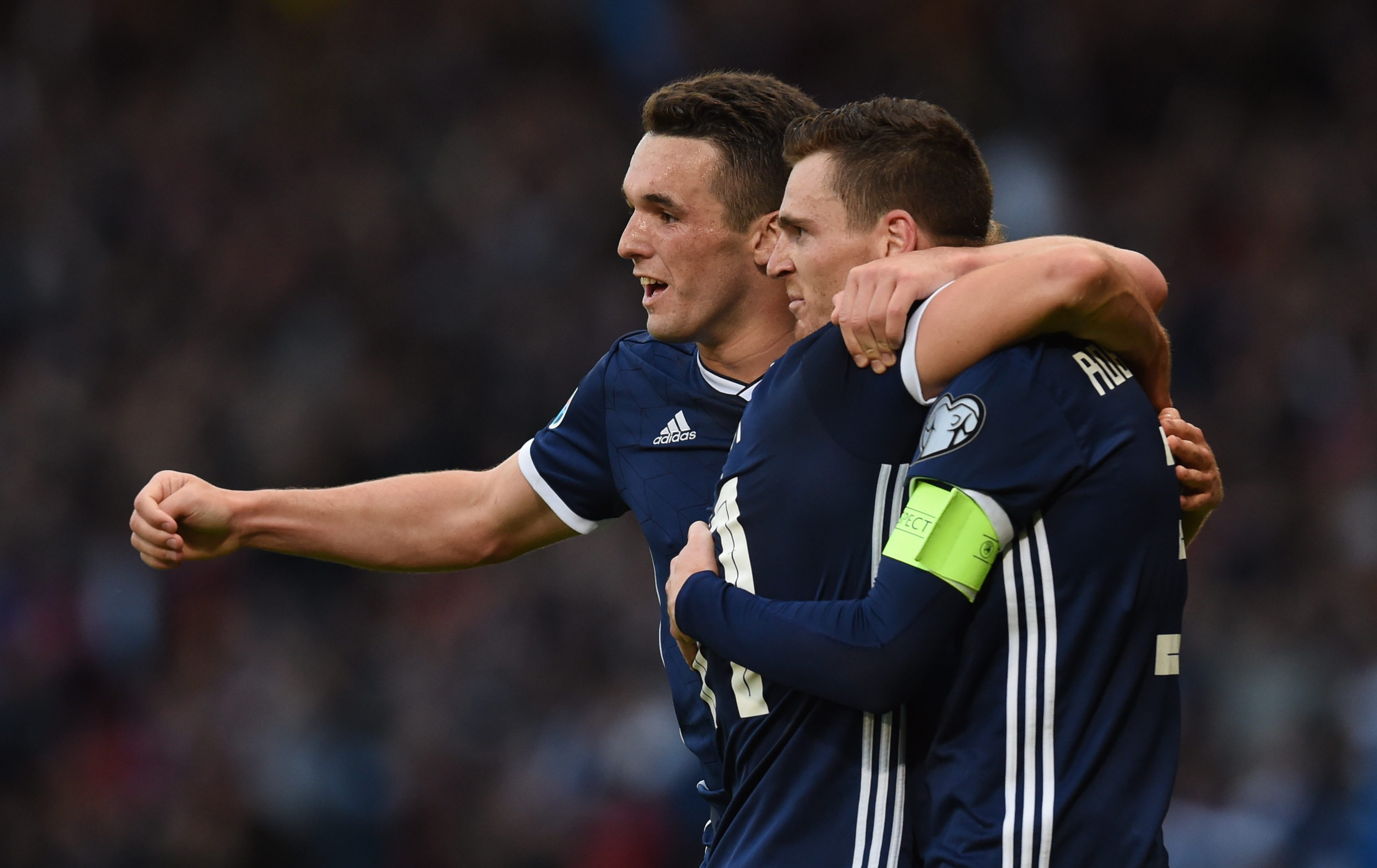 John McGinn joins in the celebrations after Andy Robertson's goal.