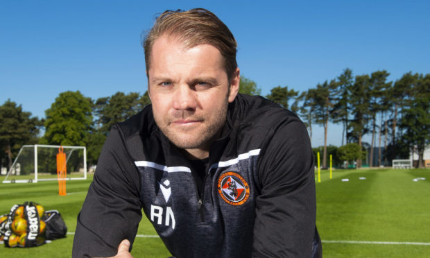 A relaxed Robbie Neilson at United's St Andrews training camp.