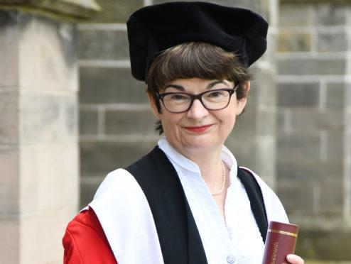 Professor Sally Mapstone picks up the honorary degree.