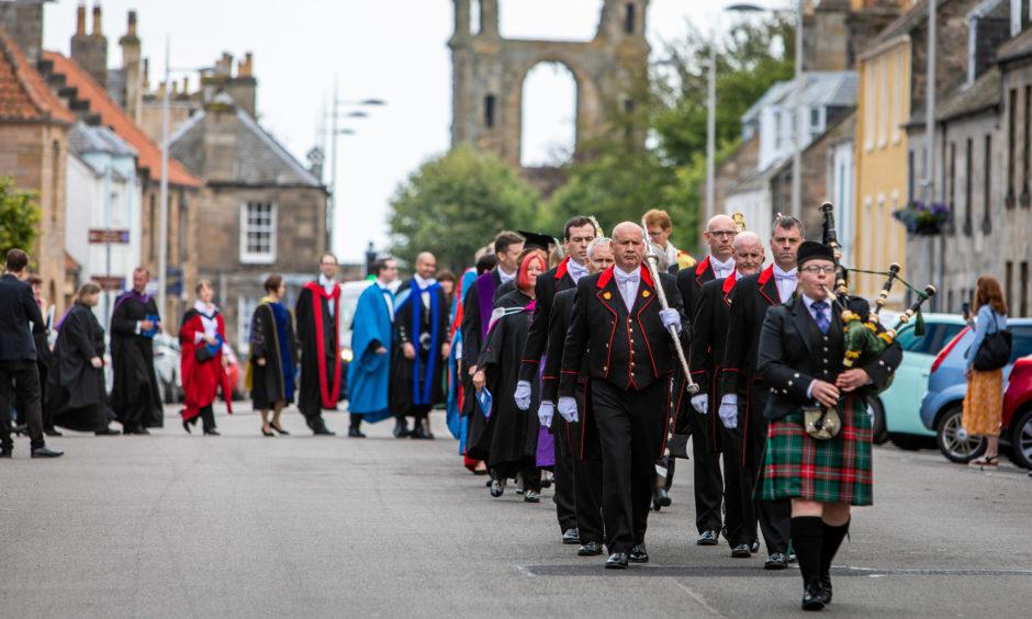 University procession heads towards St Salvators Quad after 2019 graduation ceremony.