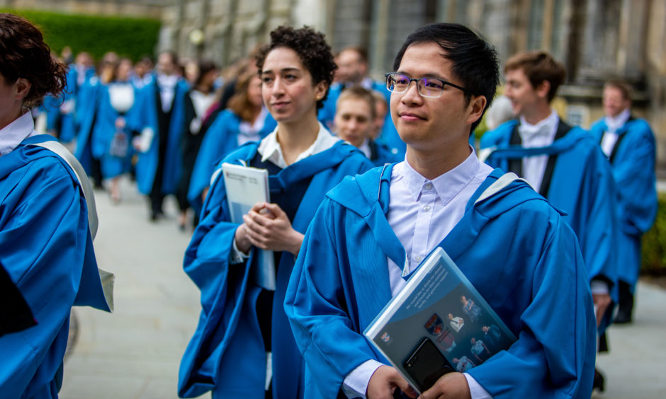 Graduates arrive in St Salvators Quad to meet and be greeted by parents, friends and family.