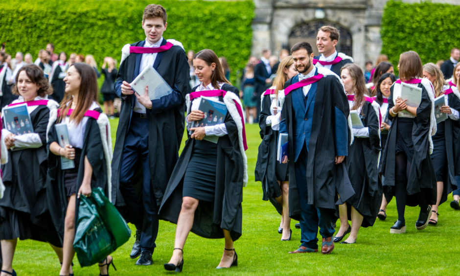 Graduates head to meet their families and continue the celebrations.