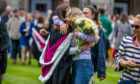 Hugs and happiness all around for these new graduates.