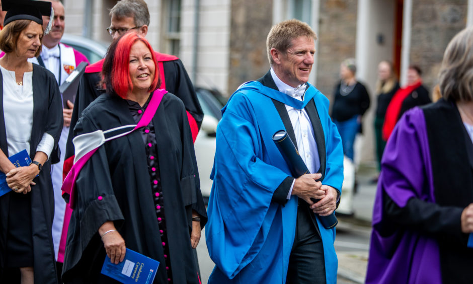 The University procession heads towards St Salvators Quad after graduation ceremony. Honourary Degree for Professor Lesley Yellowlees CBE BSc PhD HonFRSC FRSE is part of the procession.