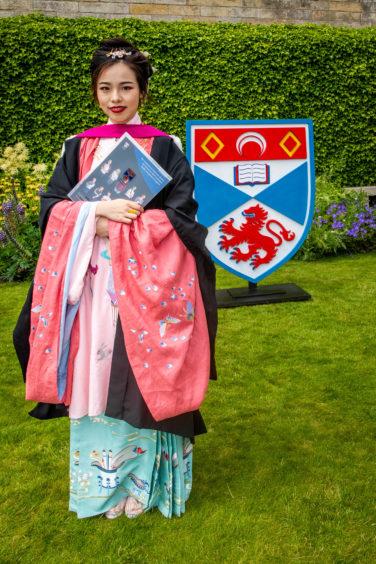 Siyao Chen (21) from China wore traditional dress.