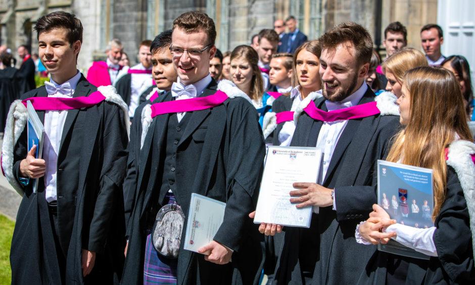 The new graduates flood to St Salvators Quad.