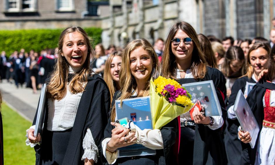 Graduates parade around St Salvators Quad.