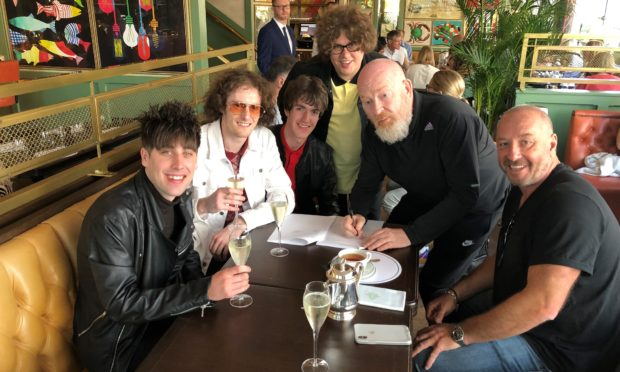 Fife band Shambolics have signed to Creation 23 - the new record label set up by music mogul Alan McGee. (from left) Jordan McHatton,  Darren Forbes, Lewis McDonald, Alan McGee, Jake Bain and Simon Fletcher