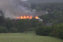 The roof of Strathmartine Hospital was on fire.
