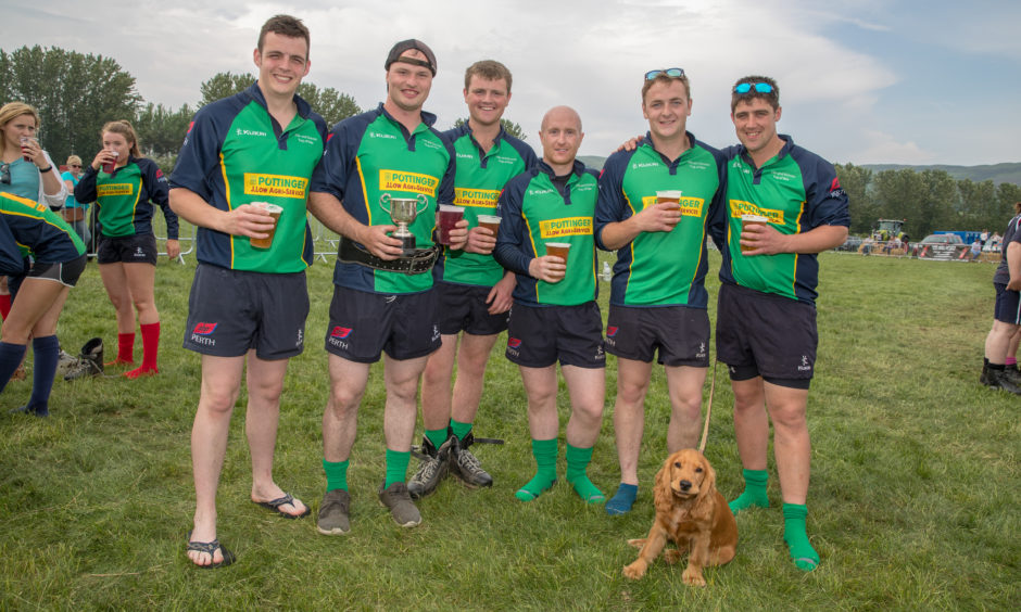 Perth & Kinross Young Farmers celebrate after winning the Tug-O War.