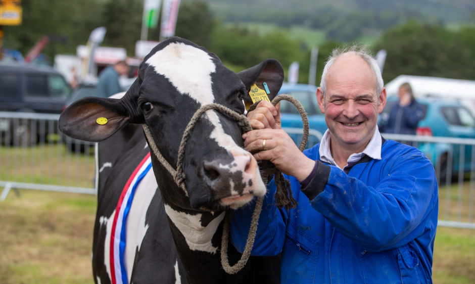 Andrew Wilson can't hide his delight after winning champion of champion with his Dairy Cow.