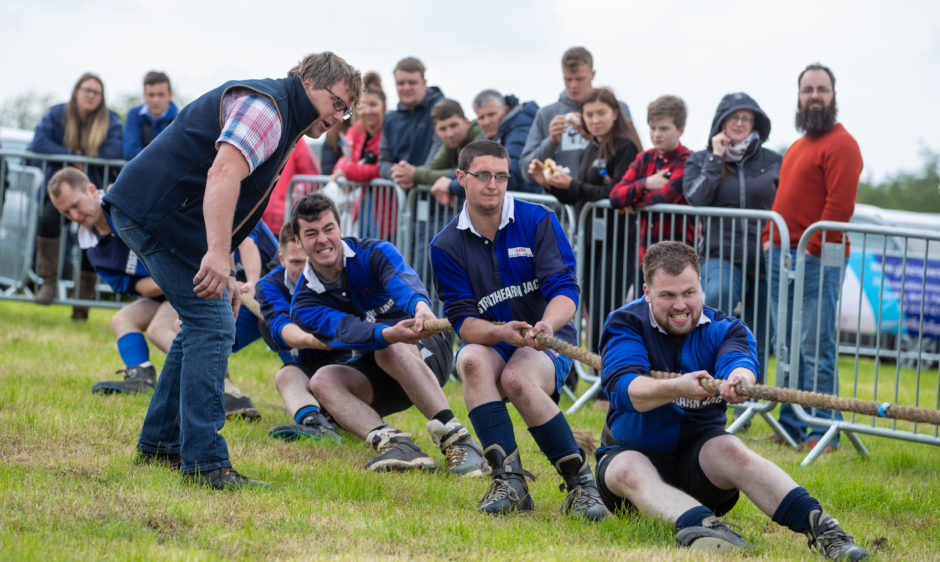 The young farmers put in the effort at the Tug-O-War.