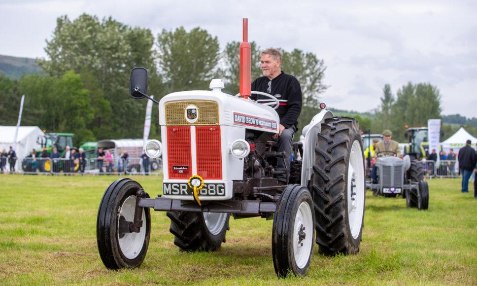 Vintage tractors on display.