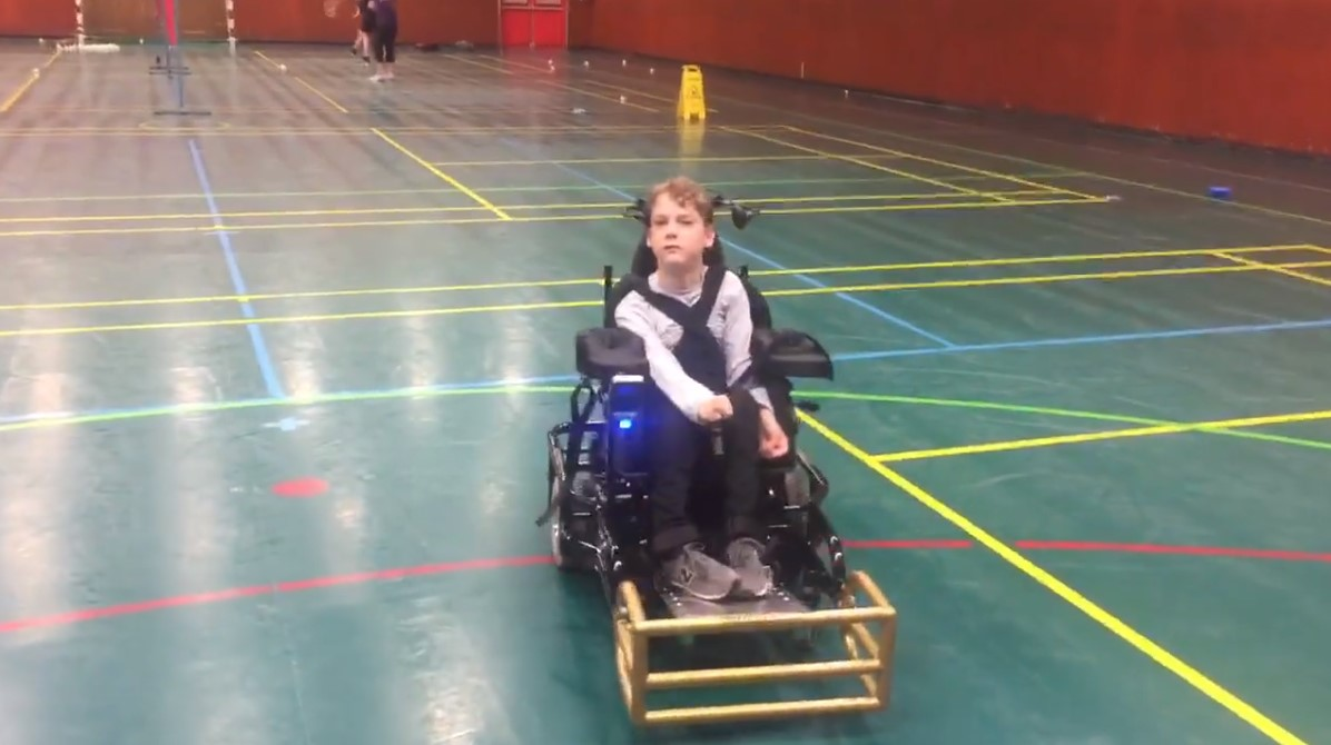 Teenager Alexander Johnstone who has received a new wheelchair.