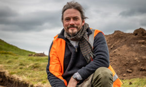 Dr Oliver O'Grady  helping to resolve a dig site at East Lomond in 2019