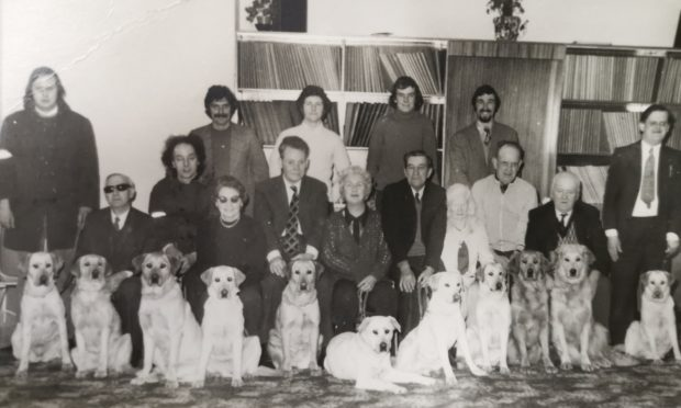 Arthur Grant, one of the first guide dog owners who qualified in Forfar, second from the left, with fellow guide dog owners.