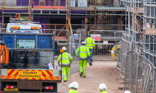 Workers install fencing at Lathro Farm site
