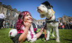 St Andrew's student Mika Schmeling, 22, graduated with her Emotional Support Dog Lulu, who has helped her complete her studies.. Picture by Mhairi Edwards/DCT Media