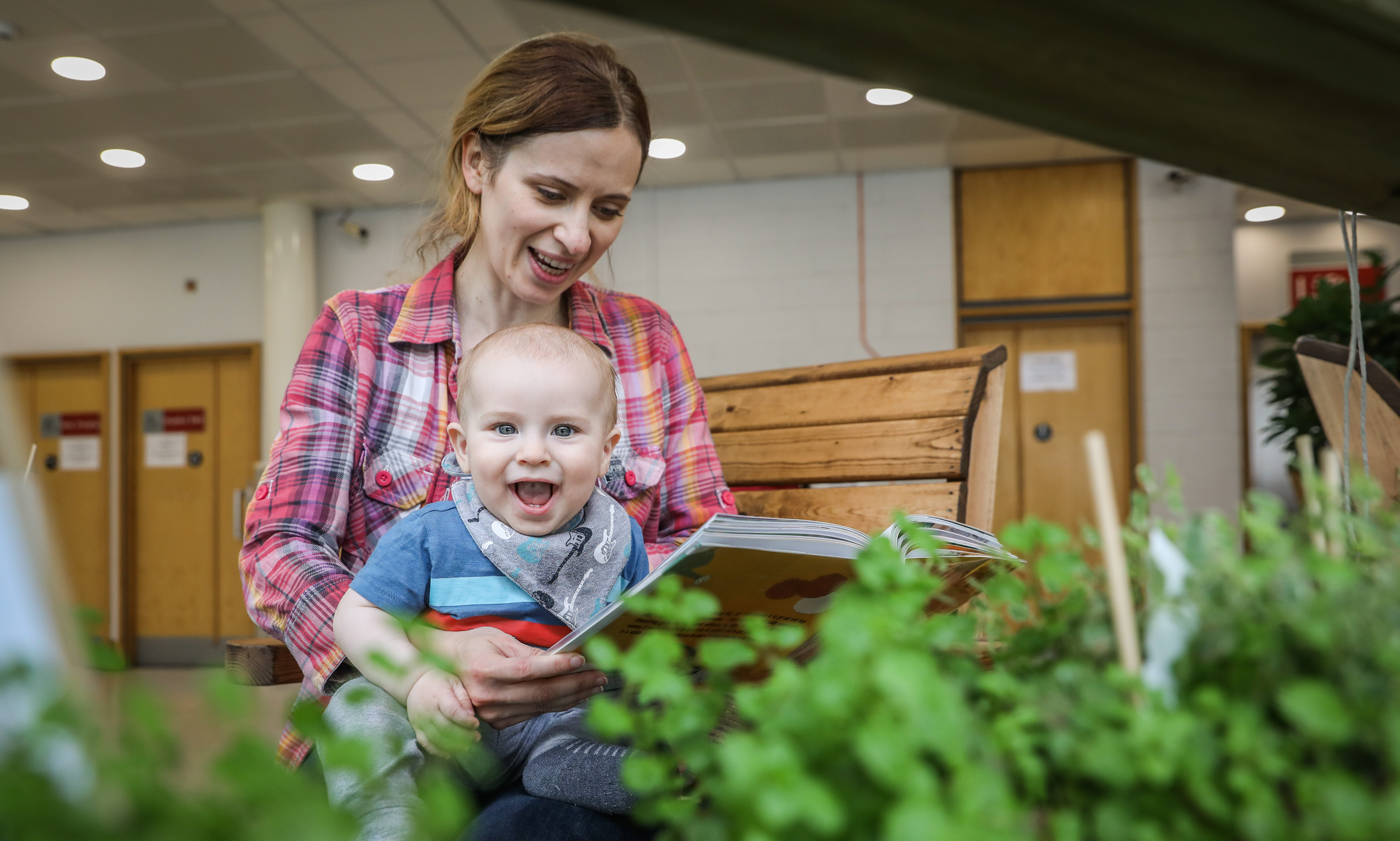 Dundee Central Library has officially launched its Wellbeing Garden with a special Bookbug rhymetime session for babies, parents and carers. The indoor garden has artificial grass, comfortable garden furniture and glass ceiling giving the feeling of being outdoors and is perfect for meeting up with friends, groups or simply relaxing with a good book. Picture shows; Kamila Brady, with son Sebastian, 7 and a half months, reads a book in amongst the new greenery. Picture by Mhairi Edwards/DCT Media