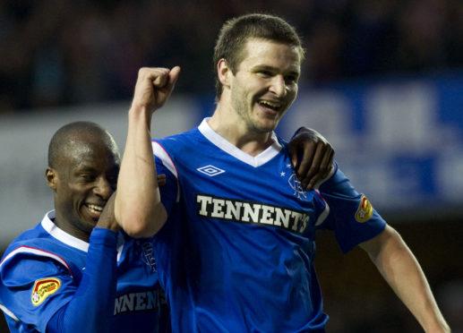 Jamie Ness celebrates scoring for Rangers against Dundee United.