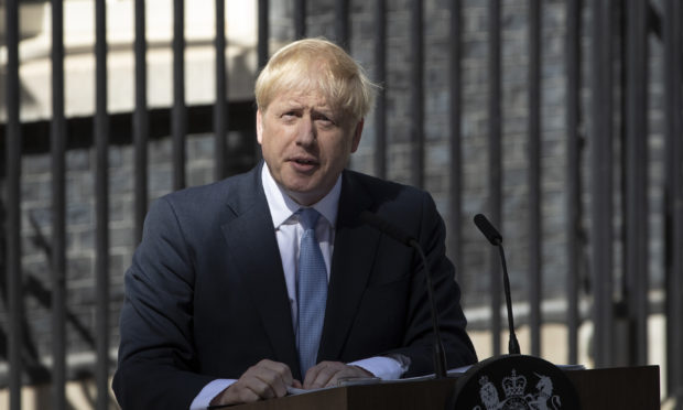 New Prime Minister Boris Johnson speaks to media outside Number 10 Downing Street.