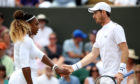 Andy Murray of Great Britain (R) and Serena Williams of the United States in their Mixed Doubles third round match against Bruno Soares of Brazil and Nicole Melichar of the United States.
