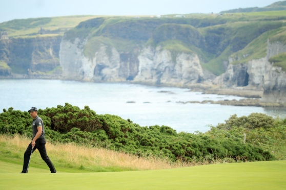 2016 champion Henrik Stenson on the march at the fifth at Royal Portrush, overlooking the Causeway cliffs.