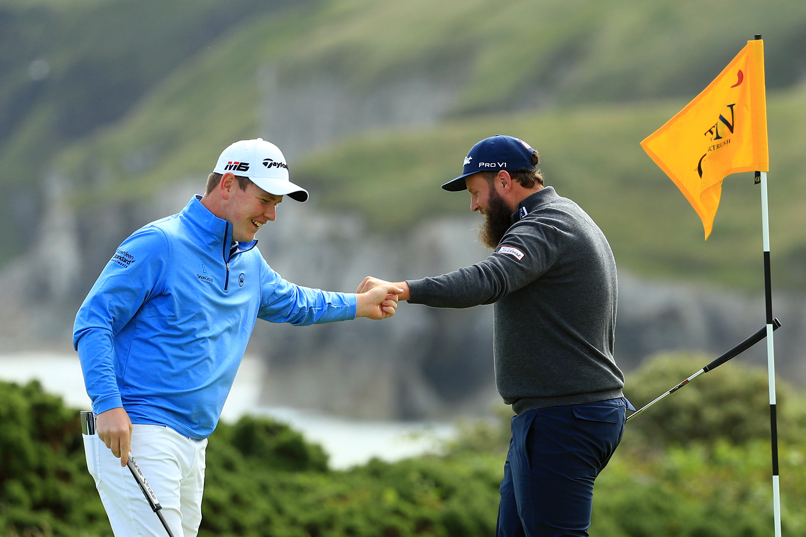 "Robert MacIntyre and Andrew ""Beef"" Johnson congratulate each other at Royal Portrush,"