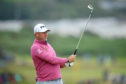 Lee Westwood tees off the 15th at Portrush yesterday.