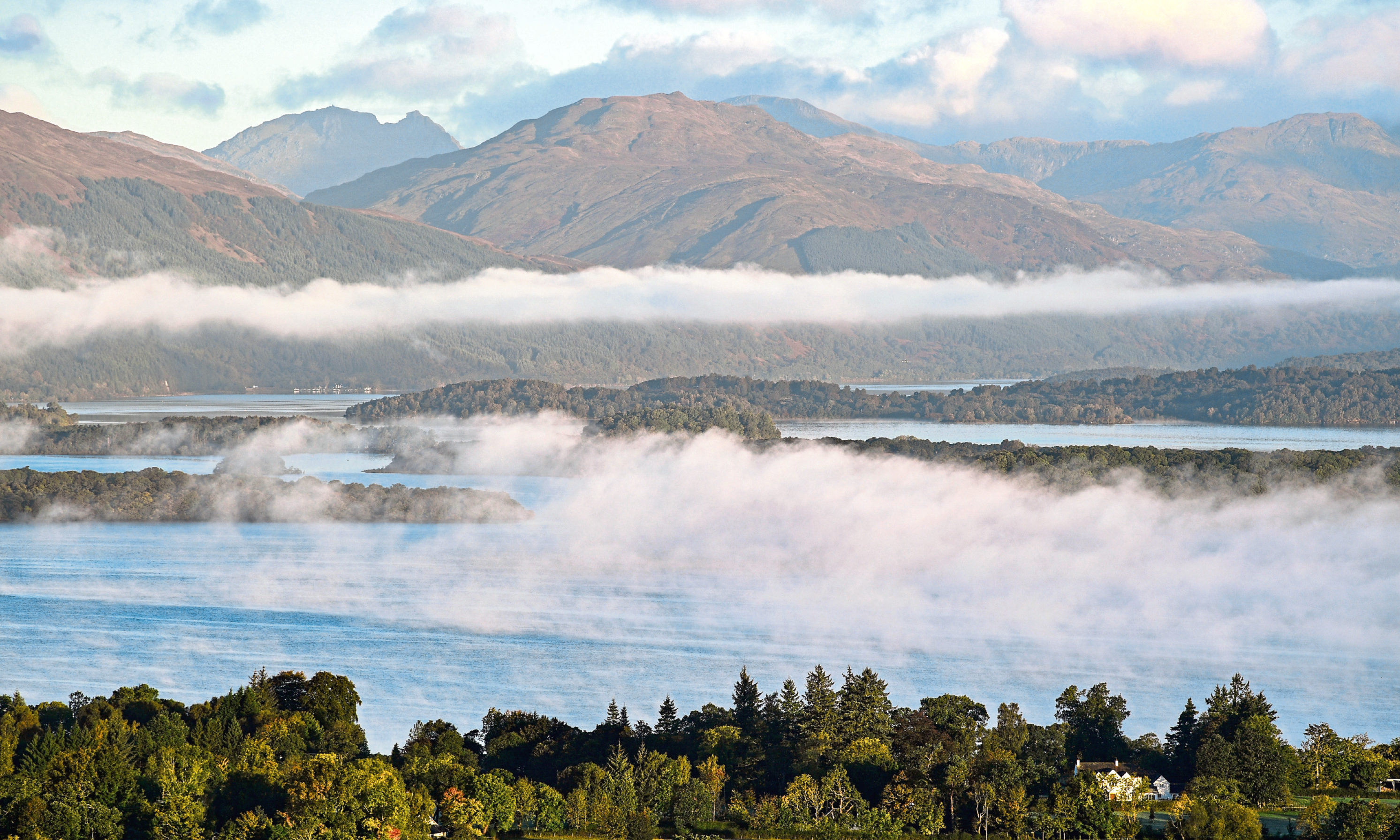 A view from Duncryne Hill of mist sitting over Loch Lomond.