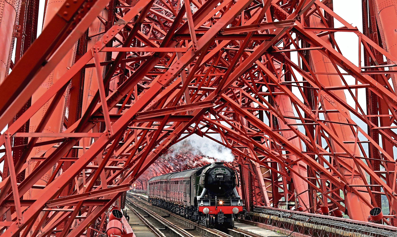 A steam train crossing the Forth Bridge
