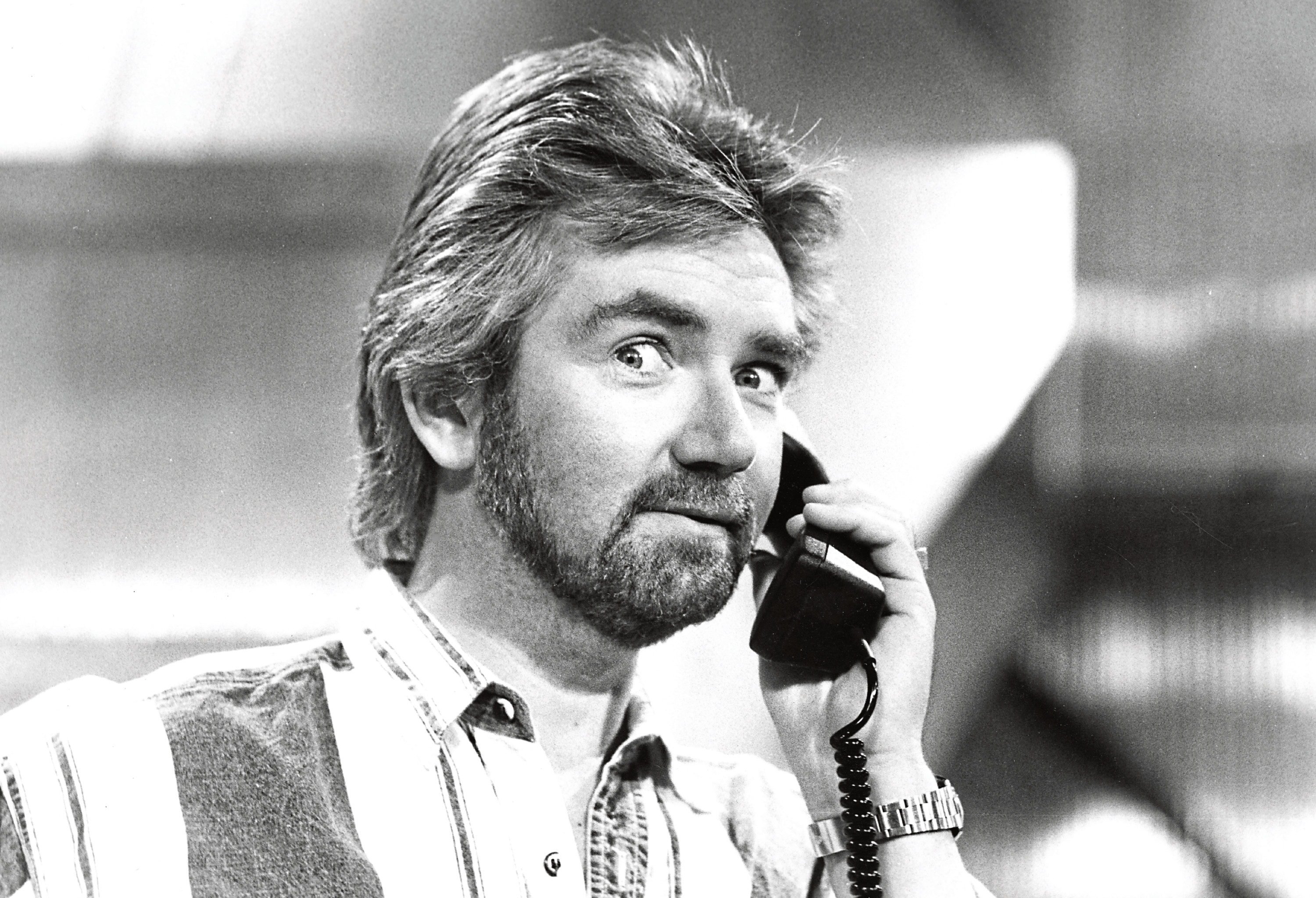 Presenter Noel Edmonds using a telephone on the set of a television show, October 24th 1989. (Photo by Don Smith/Radio Times/Getty Images)