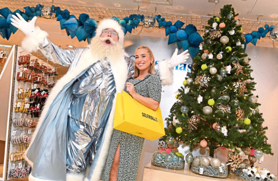 LONDON, ENGLAND - JULY 29: Santa Claus poses with a member of staff during the Selfridges London Christmas shop opening at Selfridges on July 29, 2019 in London, England. (Photo by Stuart C. Wilson/Getty Images)