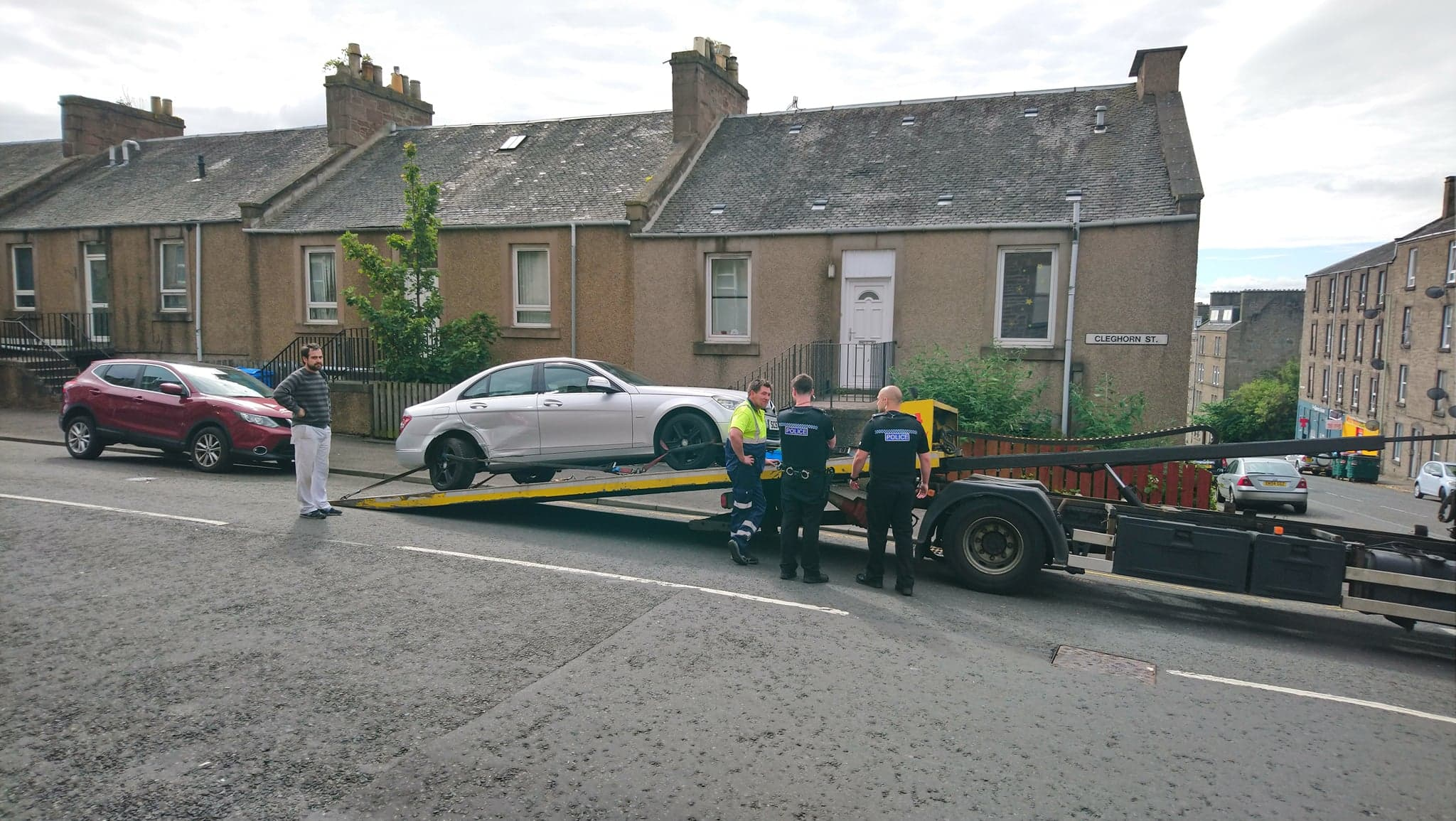 One of the cars being removed in Cleghorn Street.