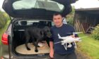 Dale Summerton with Buster and the drone he used to help find the missing dog.